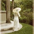 Victorian Woman In Garden With Parasol by Jill Battaglia