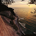 View Looking Down Cliffs At Sunset by Norbert Rosing