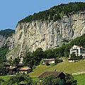 View Of Greenery And Waterfalls On A Swiss Cliff by Ashish Agarwal