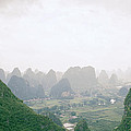 View Of The Guilin Mountains In Guangxi In China by Shaun Higson