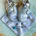 Vintage Baby Shoes And Diaper Pin On Handkercheif by Jill Battaglia