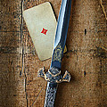 Vintage Dagger On Wood Table With Playing Card by Jill Battaglia