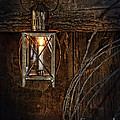 Vintage Lantern Hung In A Barn by Jill Battaglia