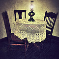Vintage Table And Chairs By Oil Lamp Light by Jill Battaglia