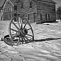 Wagon Wheel In Winter by Randall Nyhof