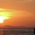 Watching A Sunset From The Jetty by Thepurpledoor