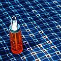 Water Bottle On A Blanket by Eric Tressler