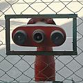 Water Hydrants Built Into A Wire Mesh Fence by Ashish Agarwal