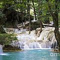 Waterfall In Deep Forest by Setsiri Silapasuwanchai