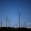 Wind Farm At Night by Keith Kapple