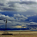 Windmill And Angry Skies by Russell Miller