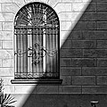 Window And Shadow On A Wall With Bike by Silvia Ganora