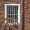 Window In Stone Building With Wagon Wheel by Thom Gourley/Flatbread Images, LLC