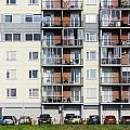 Windows  Balconies  Cars And Lawn  Of A Multiroom Apartment Hous by Aleksandr Volkov