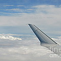 Wings Of Flying Airplane Over Clouds by Sami Sarkis