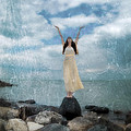 Woman By The Sea With Arms Reaching Up In Praise by Jill Battaglia