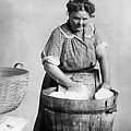 Woman Doing Laundry In Wooden Tub by Everett