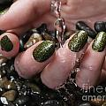 Woman Hand With Fancy Nail Polish In Water by Oleksiy Maksymenko