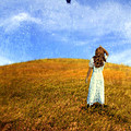 Woman In Field Looking Up At An Airplane by Jill Battaglia