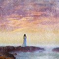 Woman In Vintage Dress At The Rocky Shore At Dawn by Jill Battaglia