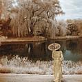 Woman In Vintage Dress With Parason By Lake by Jill Battaglia