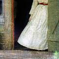 Woman In Vintage Victorian Era Dress In Doorway by Jill Battaglia