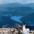 Woman In White Gown On Mountain Top by Jill Battaglia