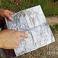 Woman On Country Road Pointing Map by Sami Sarkis