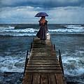 Woman On Dock In Storm by Jill Battaglia