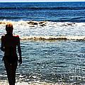 Woman Walking Into Ocean Surf  by Susan Stevenson