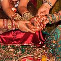Women With Decorated Hands Holding Hands In A Hindu Religious Ceremony by Ashish Agarwal