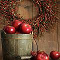 Wood bucket of apples for the holidays by Sandra Cunningham