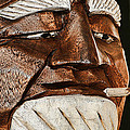 Wooden Head With Cigarette by Kathy Clark