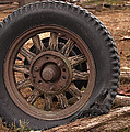 Wooden Spoked Tire by Grant Groberg