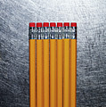 Yellow Pencils With Erasers On Stainless Steel. by Ballyscanlon