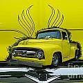 Yellow Truck In Truck Grill by Randy Harris