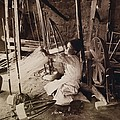 Young Boy Unwinding Silk Cocoons by Everett