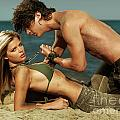 Young Couple On The Beach by Oleksiy Maksymenko