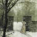 Young Lady By Stone Pillar In Snow by Jill Battaglia