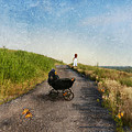 Young Woman And Baby Buggy On Dirt Road  by Jill Battaglia