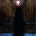 Young Woman In Black Lantern In Front Of Her Face by Jill Battaglia