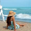 Young Woman Sitting On A Beach by Jill Battaglia