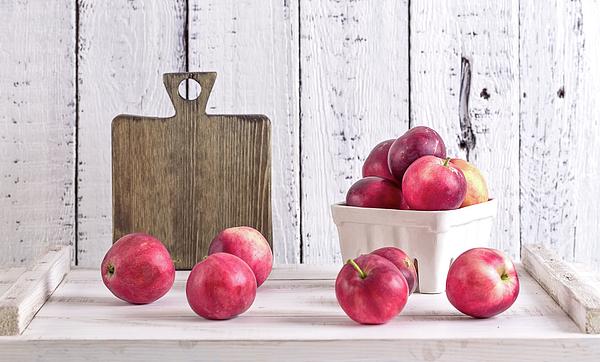 Oksana Ariskina - Red Apples On A Wite Rustic Wood Table