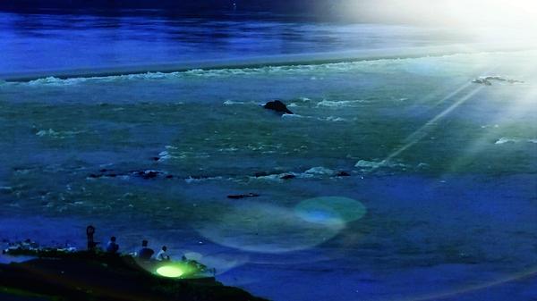 Nilu Mishra - Riverview at night