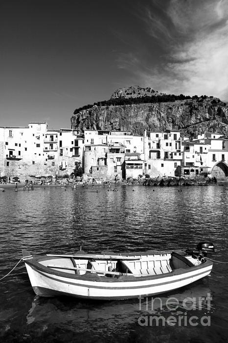 Stefano Senise - Rowboat along an idyllic Sicilian village.