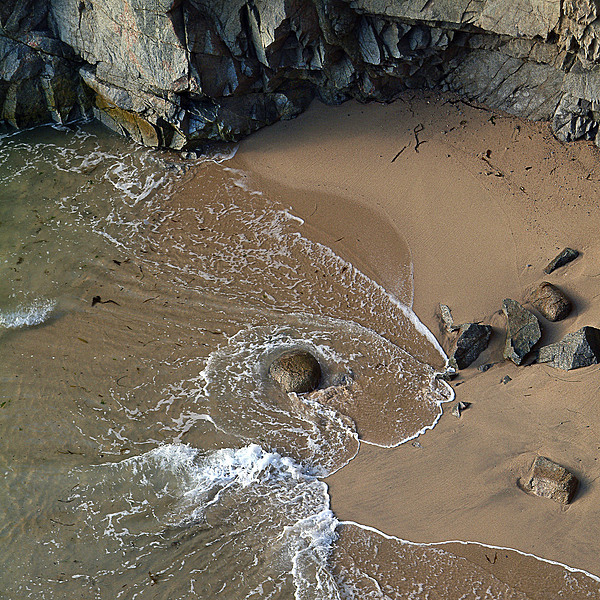 Swirling Surf And Rocks Photograph