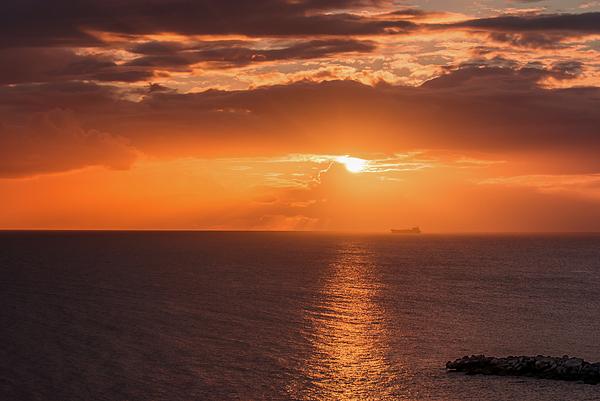 Zina Stromberg - Thank ship at sunset in Atlantic ocean