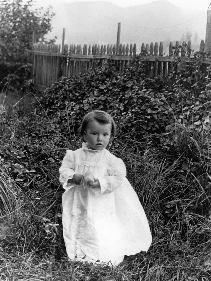 Girl photograph girl standing in garden 1900s black white kids by mark goebel