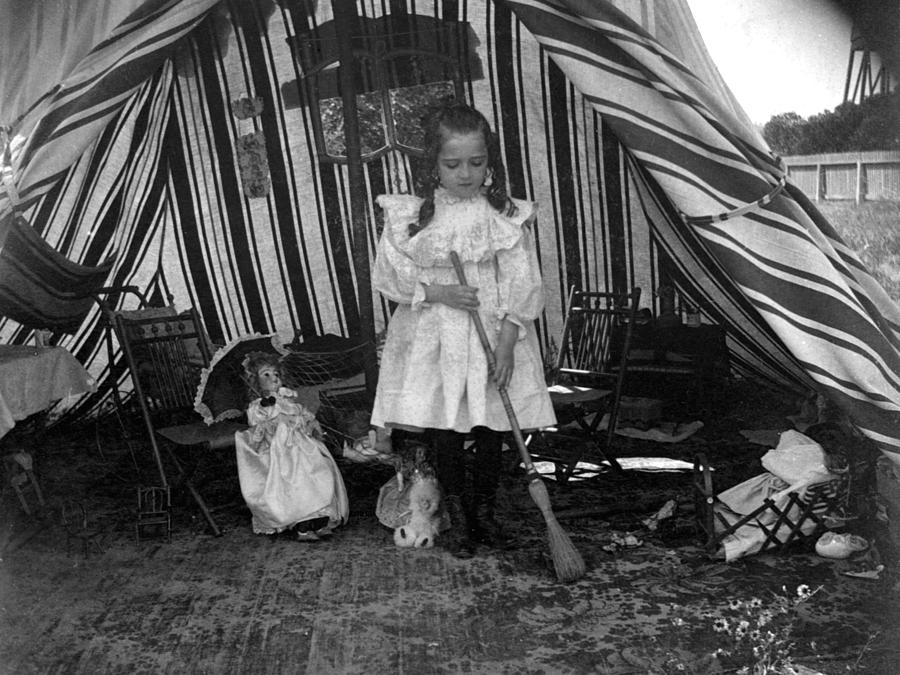 Girl photograph girl sweeping in play tent 1900s black white by mark goebel