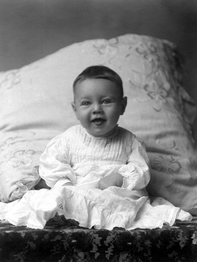 Portrait photograph portrait headshot happy baby 1900s black white by mark goebel